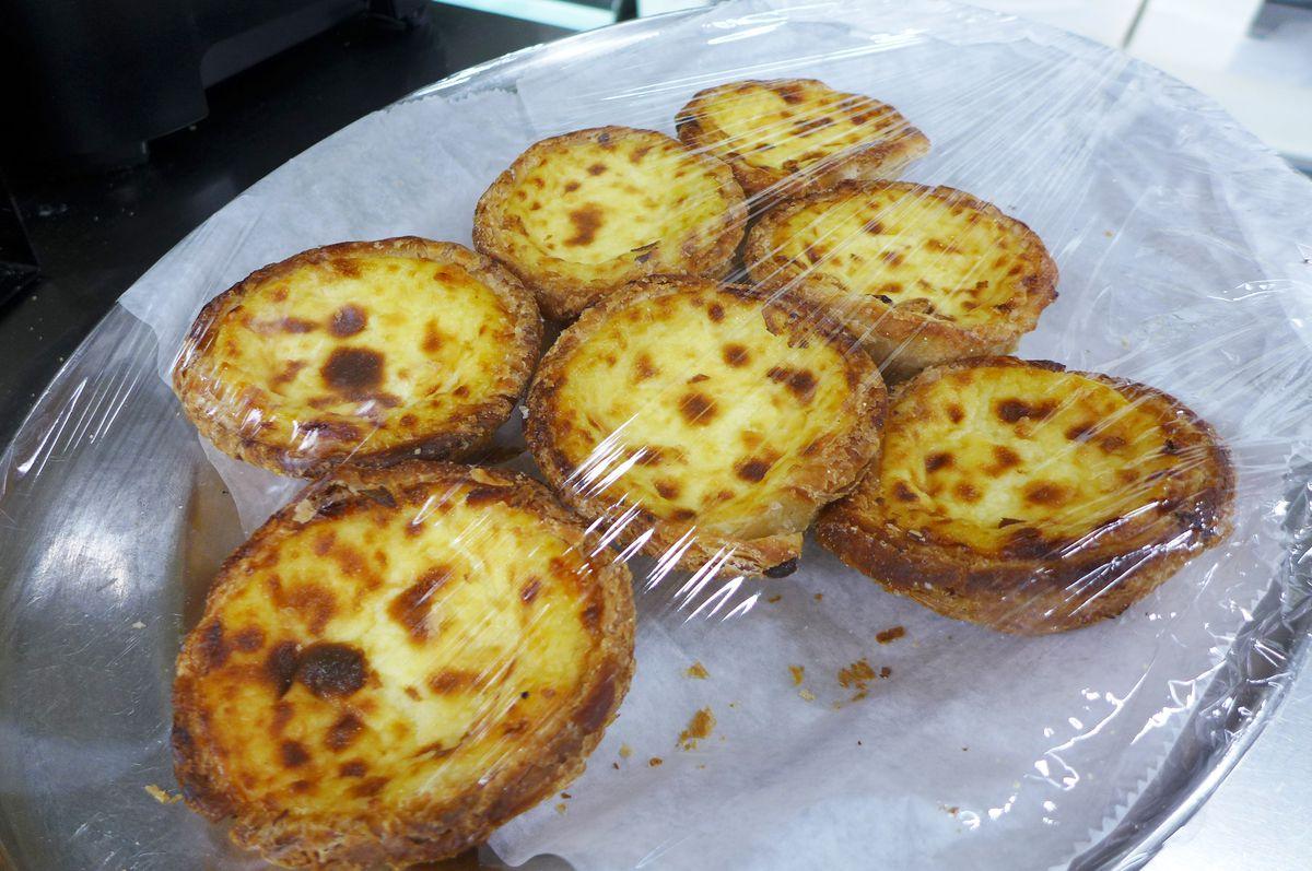 Little custard pies on a platter.