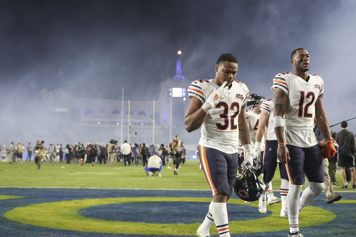 Running back David Montgomery and wide receiver Allen Robinson of the Chicago Bears leave the field after being defeated by the Los Angeles Rams at Los Angeles Memorial Coliseum on November 17, 2019 in Los Angeles, California.