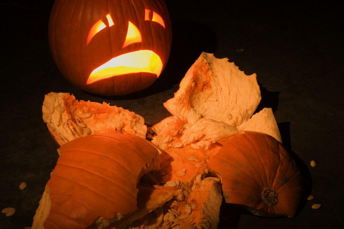 A jack o lantern cries at the sight of a smashed pumpking