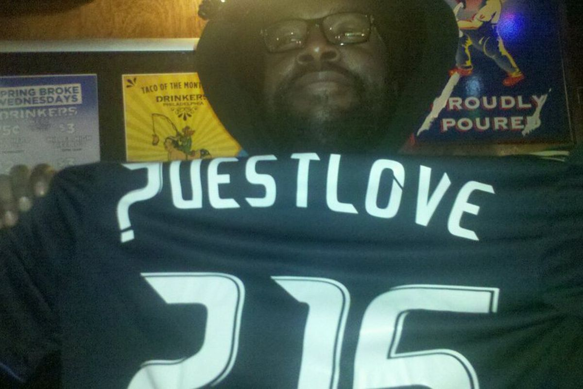 Questlove of the Roots holds up a Philadelphia Union jersey customized for him by the team. (Photo courtesy of @KChristine)