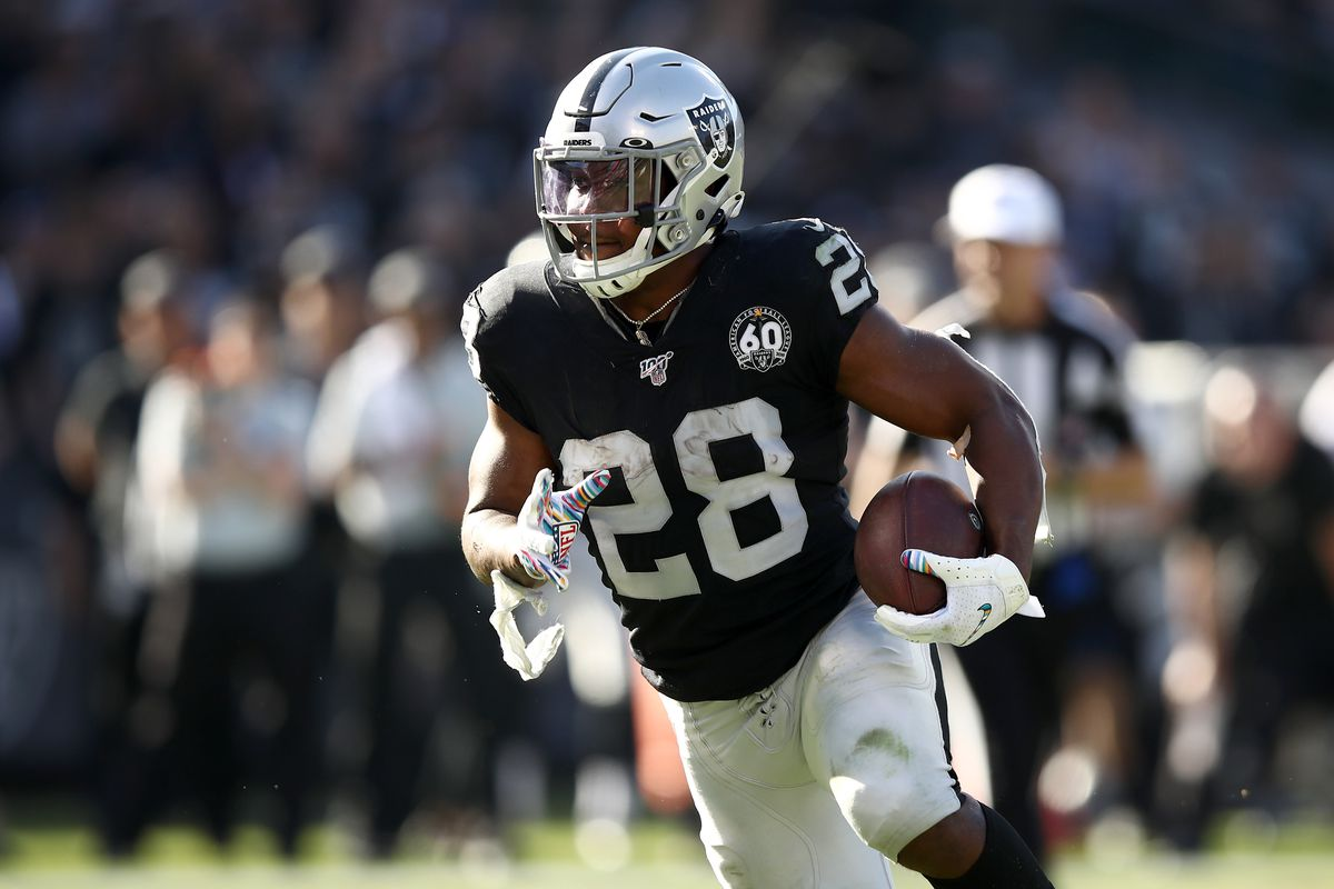 Josh Jacobs #28 of the Oakland Raiders runs in for a touchdown against the Detroit Lions at RingCentral Coliseum on November 03, 2019 in Oakland, California.
