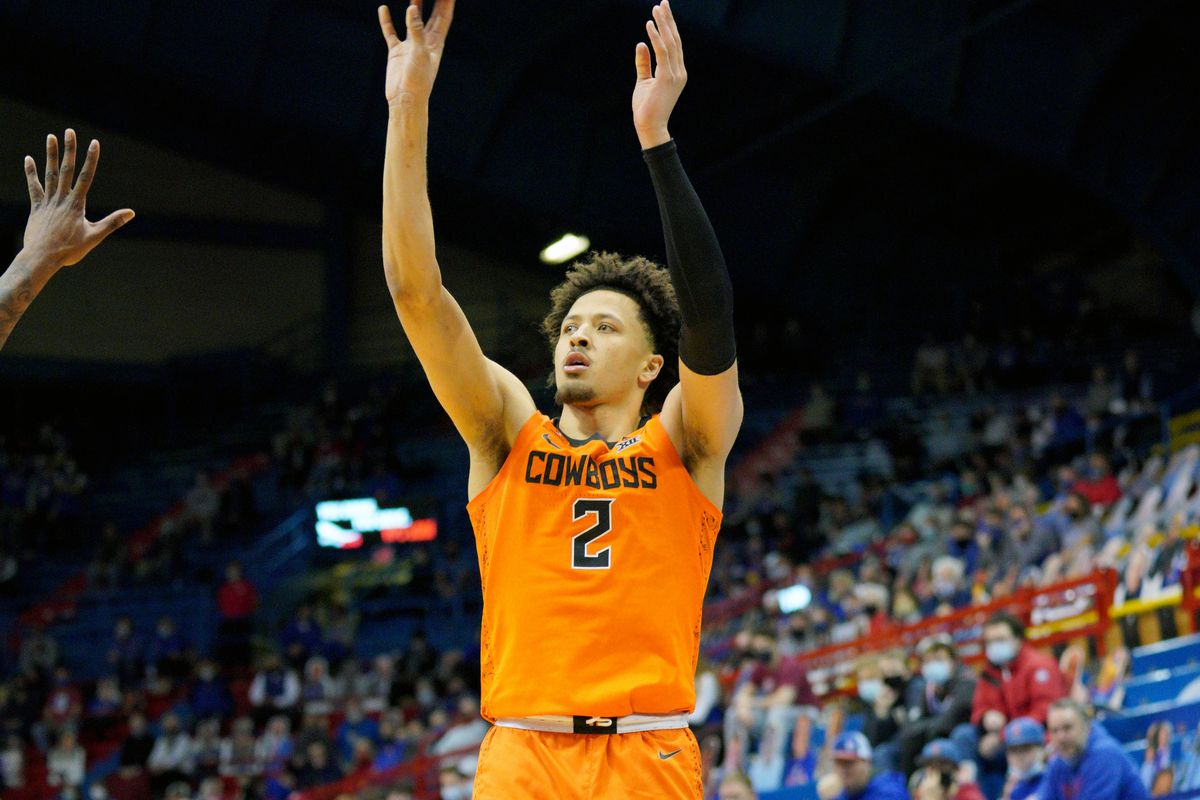 Oklahoma State Cowboys guard Cade Cunningham shoots a three point shot during the second half against the Kansas Jayhawks at Allen Fieldhouse.