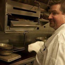 Tim Radigan cooks the burger.