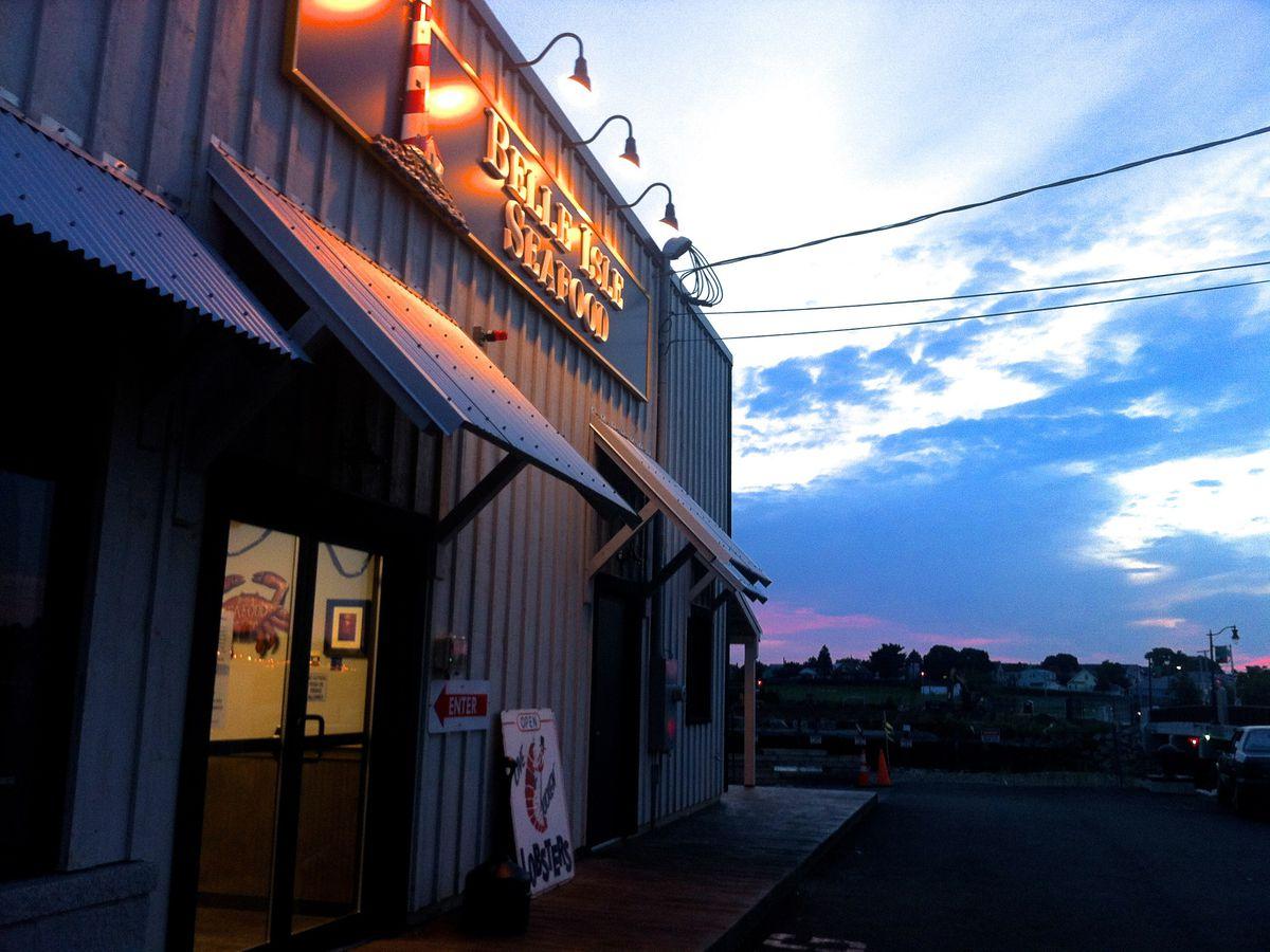 Exterior of a no-frills seafood restaurant at sunset