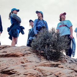 Students from the University of Virginia's Alternative Spring Break program viewing the sunset at Canyonlands National Park, shortly after being kicked out of their campsite in Southern Utah because someone else had reserved the site. The program has been entirely run by students since its inception in 1992, with no oversight from faculty, administration or alumni.
