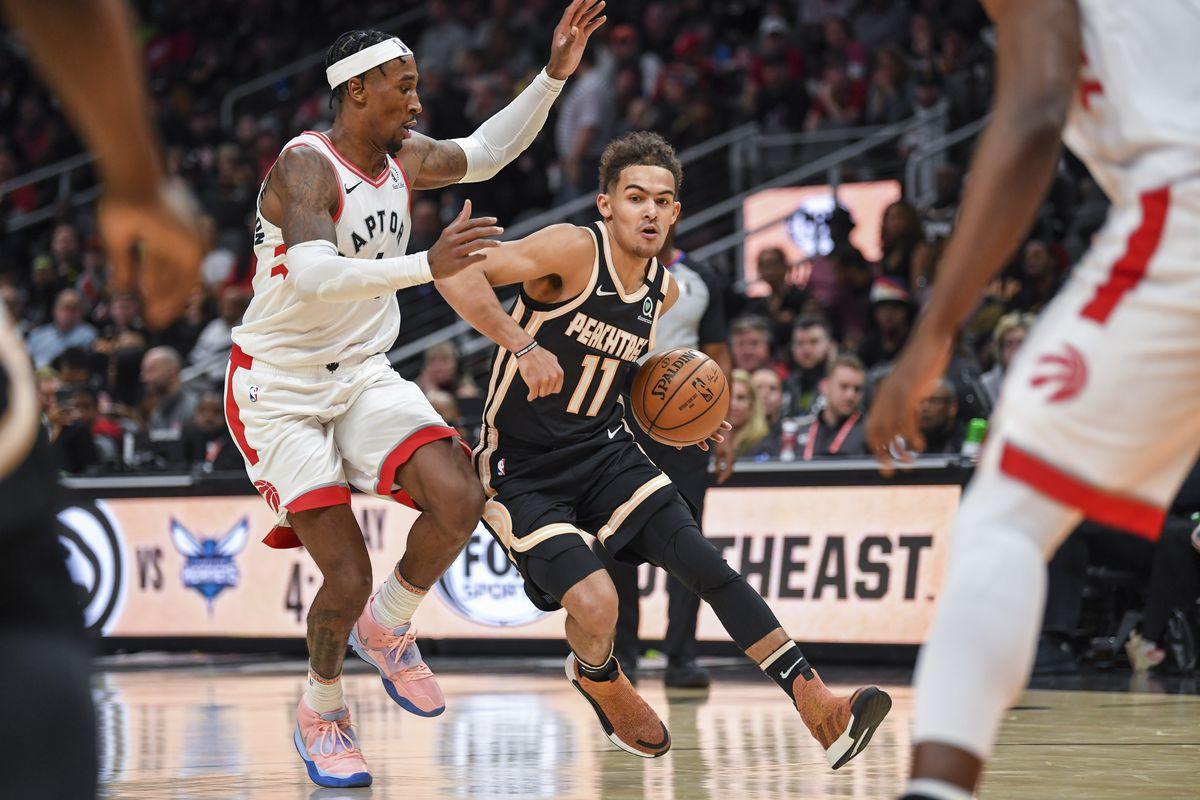 Atlanta Hawks guard Trae Young dribbles past Toronto Raptors forward Rondae Hollis-Jefferson (4) during the second half at State Farm Arena.