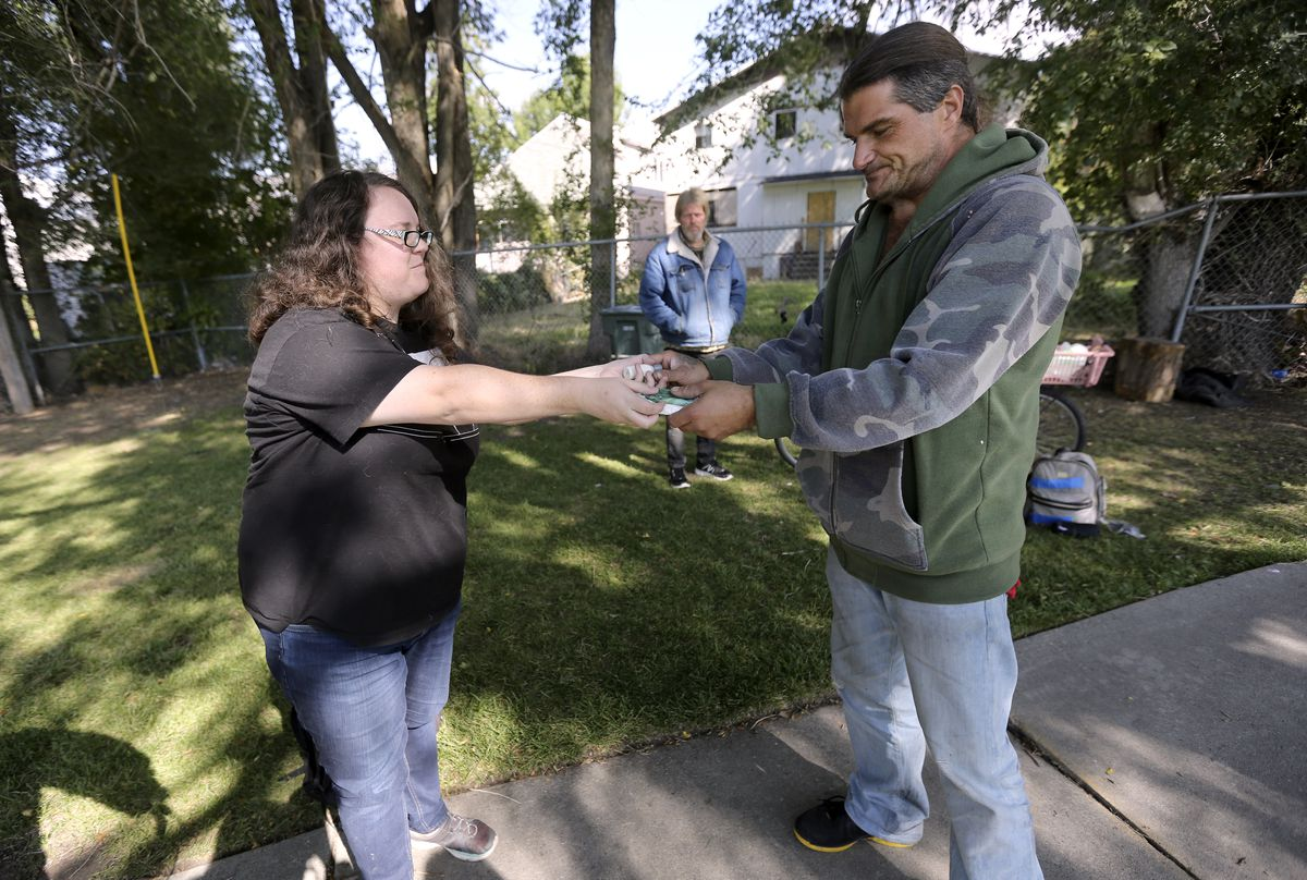 Courtney Slater, street outreach specialist with Weber Housing Authority, gives toiletries to Donavon Rowell in Ogden on Tuesday, Oct. 1, 2019. Rowell has been homeless for about a year.