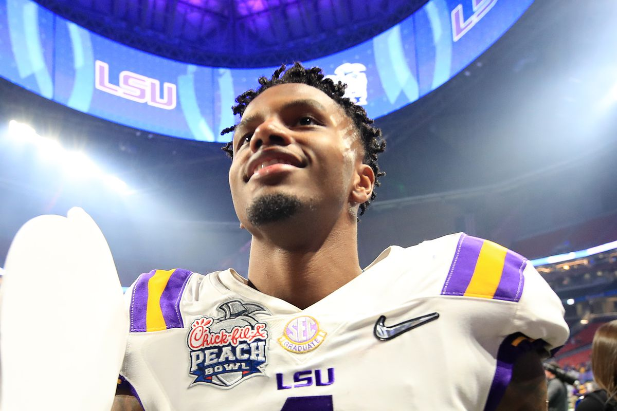 Wide Receiver Ja'Marr Chase #1 of the LSU Tigers walks off the field after winning the Chick-fil-A Peach Bowl 28-63 over the Oklahoma Sooners at Mercedes-Benz Stadium on December 28, 2019 in Atlanta, Georgia.