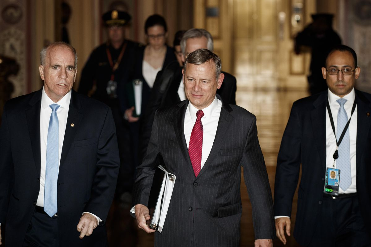 Chief Justice John Roberts walks through the halls of the U.S. Senate after swearing in for the Senate impeachment trial against President Donald Trump, in Washington, DC, on January 16, 2020.