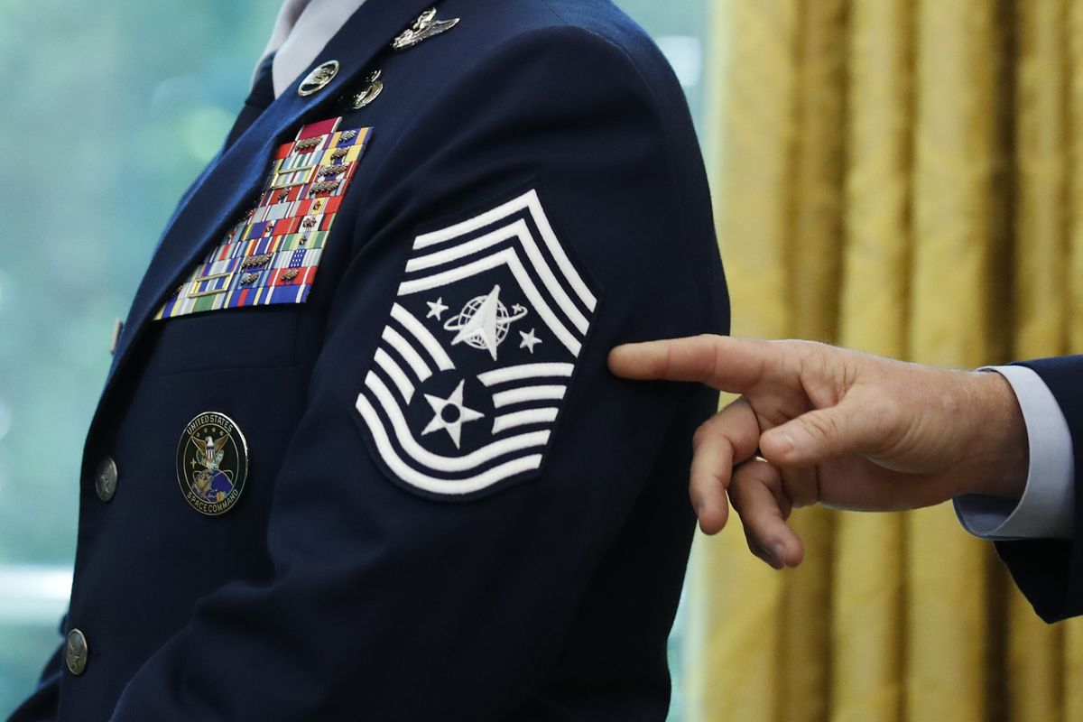 In this May 15, 2020, file photo, Chief Master Sgt. Roger Towberman displays his insignia during a presentation of the United States Space Force flag in the Oval Office of the White House in Washington.