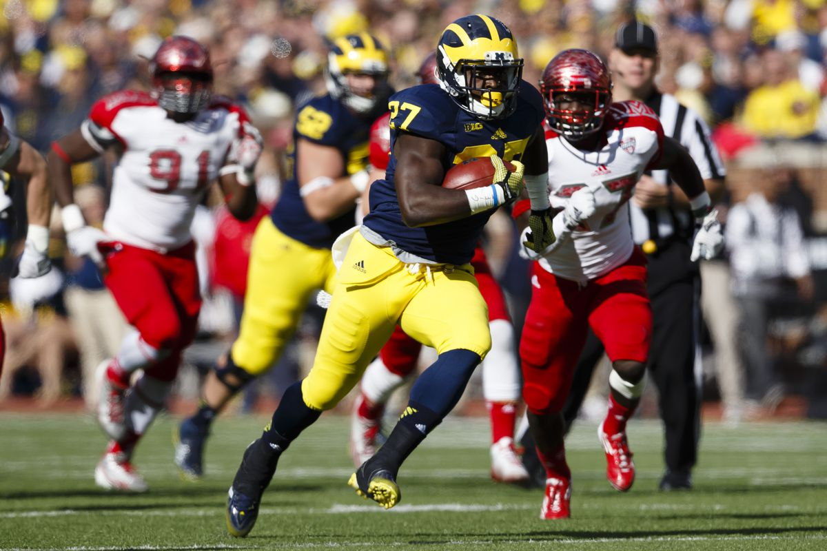 Utah's front seven will be tested by the power running scheme of the Michigan Wolverines, as well as their running back Derrick Green (27).