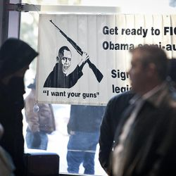 Anti-regulation signage at the South Towne Expo Center during the 2013 Rocky Mountain Gun Show, Saturday, Jan. 5, 2013.