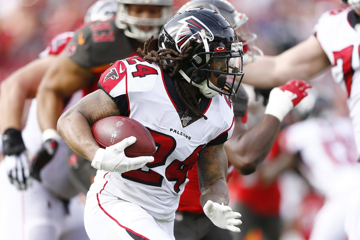 Devonta Freeman of the Atlanta Falcons in action against the Tampa Bay Buccaneers during the first half at Raymond James Stadium on December 29, 2019 in Tampa, Florida.