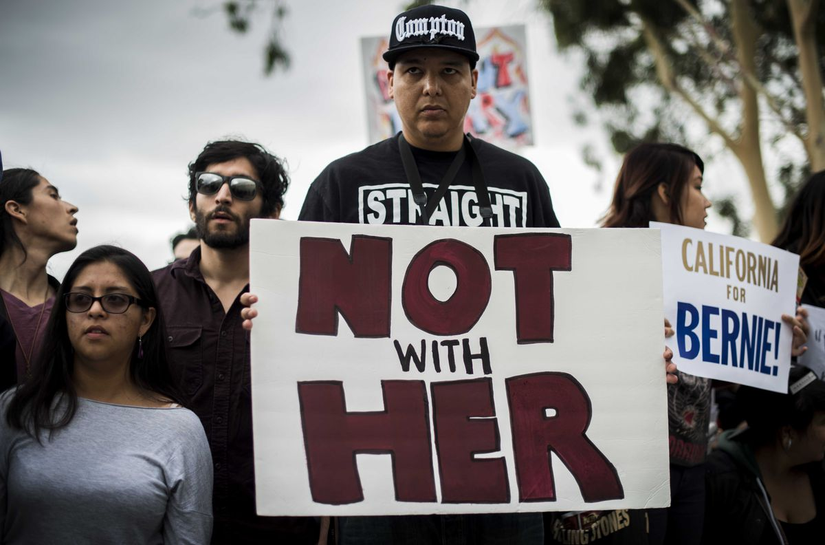 A Bernie Sanders supporter holds a NOT WITH HER sign at a California rally.