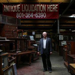 Scott R. Evans, owner of Euro Treasures Antiques, poses for a photo at the shop in Salt Lake City on Thursday, June 8, 2017.