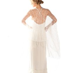 Back shot of Charcot sheer lace cardigan with Norrel white silk tank and Calista double-layered lace trim skirt