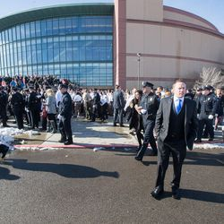 The crowd begins to break up following funeral services for Unified police officer Doug Barney at the Maverik Center in West Valley City on Monday, Jan. 25, 2016.