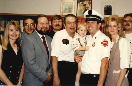Ken Little (center) with some of his family, including son Stephen Little (just right of him), now a Chicago Fire Department battalion chief. A section of Patterson Avenue near Cicero, where he raised his family, was named in his honor.   Provided photo