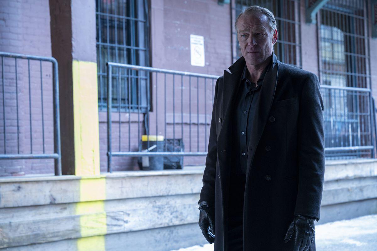 Iain Glen as Bruce Wayne in an overcoat in Titans season 3