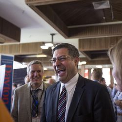 Stewart Peay shares a laugh with supporters while campaigning for the vote of Republican delegates at Timpview High School Provo on Saturday, June 17, 2017.