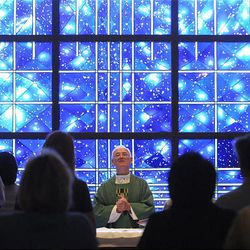 The Rev. Thomas Kenney celebrates Mass in the chapel of the National Shrine of Mary, Queen of the Universe.