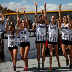 Pine View High runners celebrate their first-place team title in the 4A Girls State Cross-Country Championships at Highland High School in Salt Lake City on Wednesday, Oct. 23, 2019.