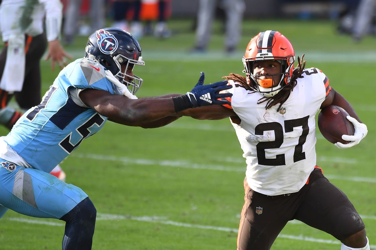 Cleveland Browns running back Kareem Hunt (27) fights off a tackle attempt from Tennessee Titans inside linebacker Rashaan Evans (54) during the second half at Nissan Stadium.