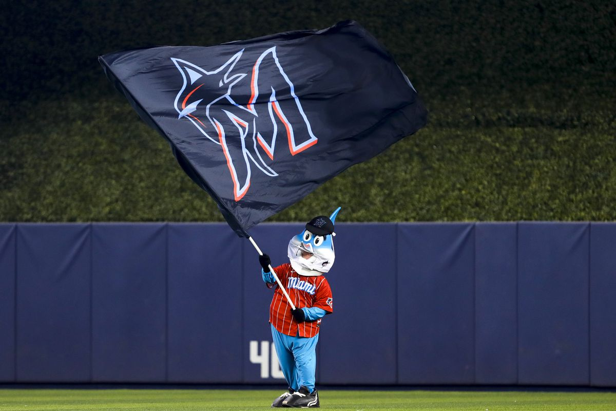 Miami Marlins mascot Billy the Marlin waves a Miami Marlins flag after winning the game against the Atlanta Braves at loanDepot Park.