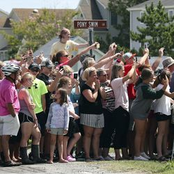 People crowd onto Pony Swim Lane to get a close look at wild ponies and foals as they are walked through the streets Chincoteague, Va., after swimming from nearby Assateague Island during the 94-year-old swim tradition of Pony Penning on Wednesday, July 24, 2019. During the event, the horses navigate through the water for a couple hundred yards, and, after resting, are walked down the streets of town and eventually end up at a carnival where the foals are actioned.