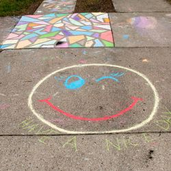 """""""Have a Nice Day"""" under a winking smiley face written in chalk on the driveway outside a home in the 1300 block of Newcastle Avenue in Westchester, Monday, April 6, 2020."""
