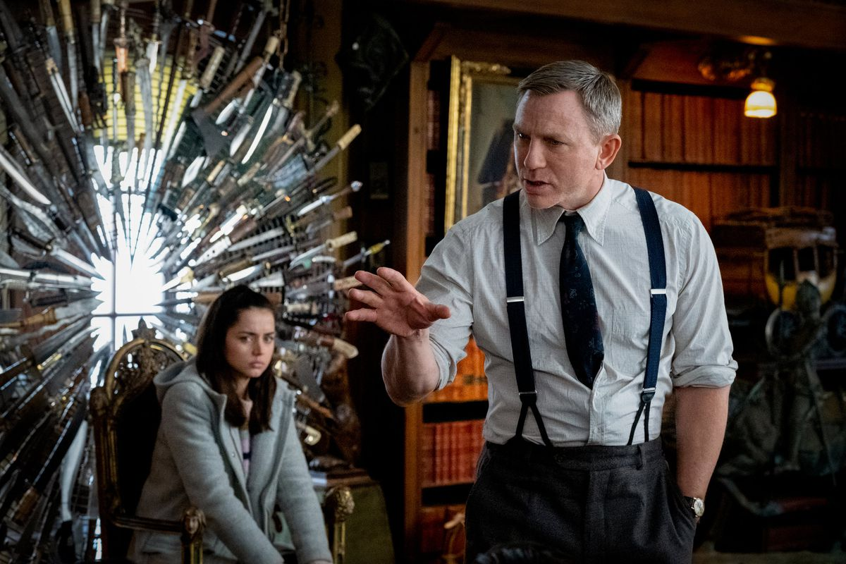 Ana de Armas and Daniel Craig puzzle over the clues in Knives Out