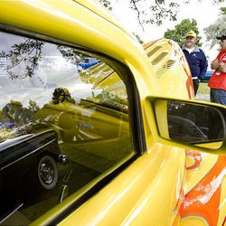Toney Johnson talks to Mike Shaw, right, next to Johnson's 1941 Ford coupe during a car show Saturday at Midvale Park in Midvale. The proceeds from the car show were donated to Shriners Hospital.