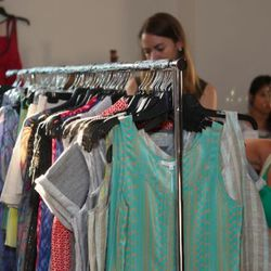 A rack of dresses and tops from Thomas Sires