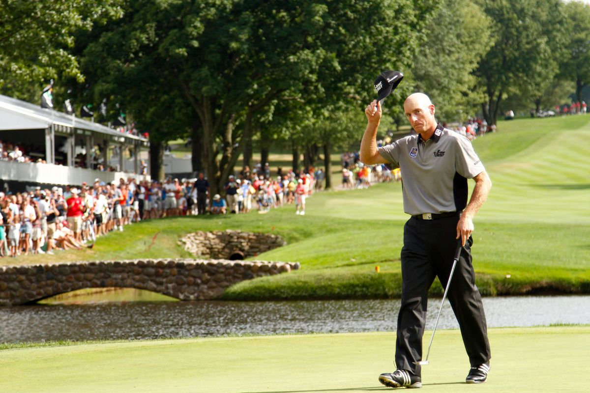 Aug. 5, 2012; Akron, OH, USA; Jim Furyk tips his cap to the crowd after making a birdie on the 16th green during the final round of the WGC-Bridgestone Invitational at Firestone Country Club-South Course.  Mandatory Credit: Debby Wong-US PRESSWIRE
