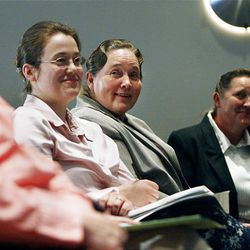 Priscilla Hammond, center, who is a member of the Centennial Park Action Committee, a fundamentalist group, laughs at a lighter moment during a forum on polygamy at the town hall meeting.