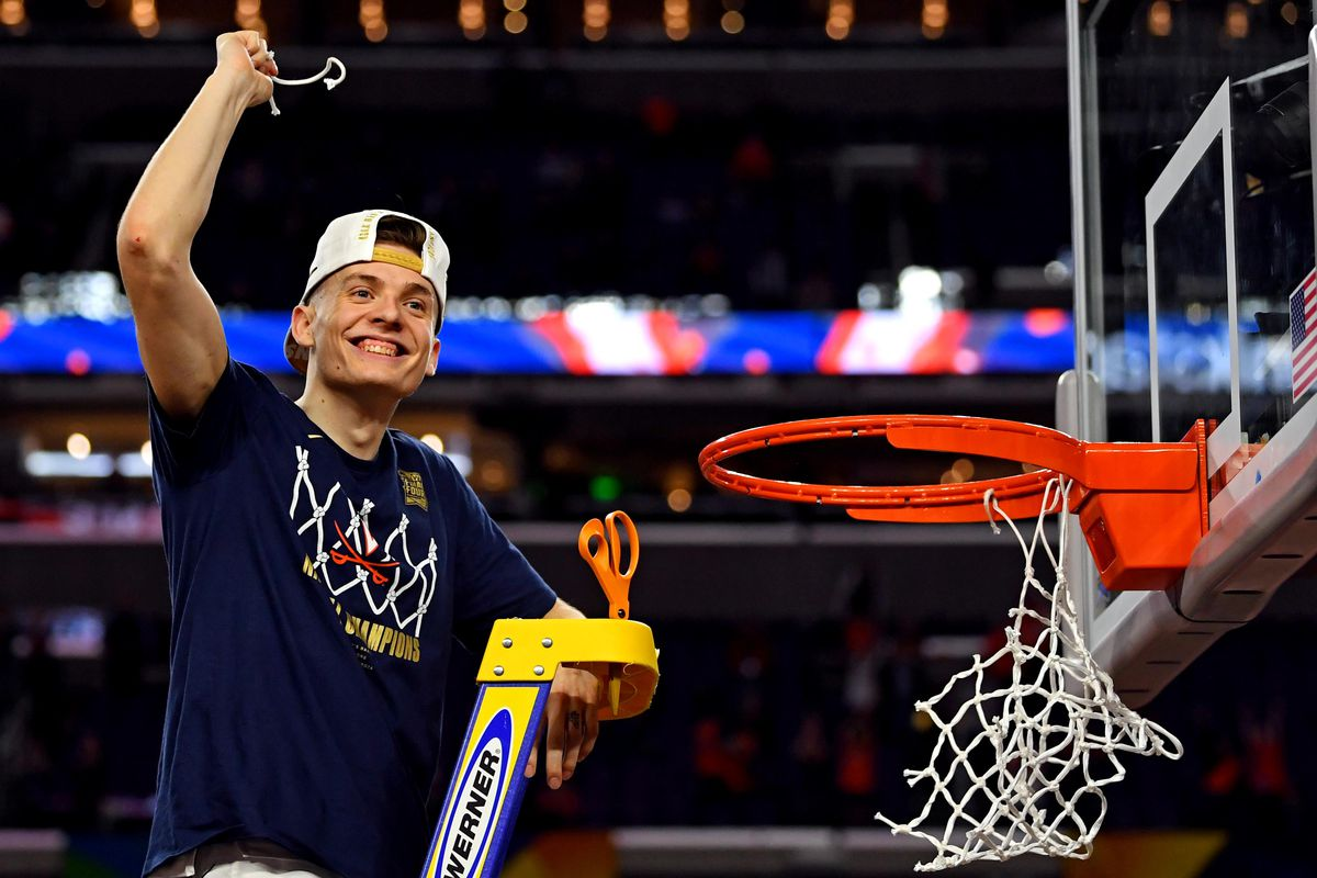 Virginia Cavaliers guard Kyle Guy cuts down the net after beating the Texas Tech Red Raiders in the championship game of the 2019 men's Final Four at US Bank Stadium.