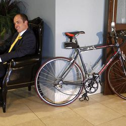 Tyler Newman, at his wedding reception, sits by the bike that led to his wedding.  He and Michelle Oliverson met when he came to buy this bike from her that she had listed on KSL.com.