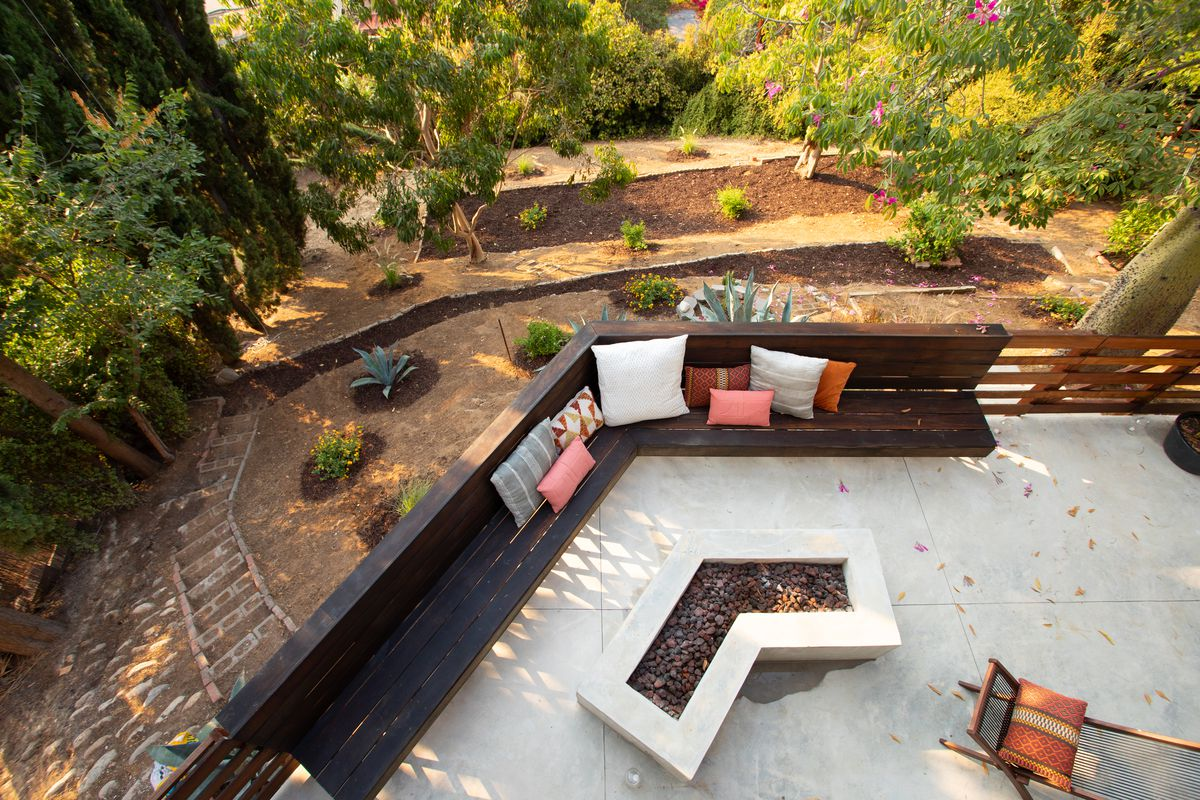 Birds-eye view of a terrace and landscaped gardens on a hill.