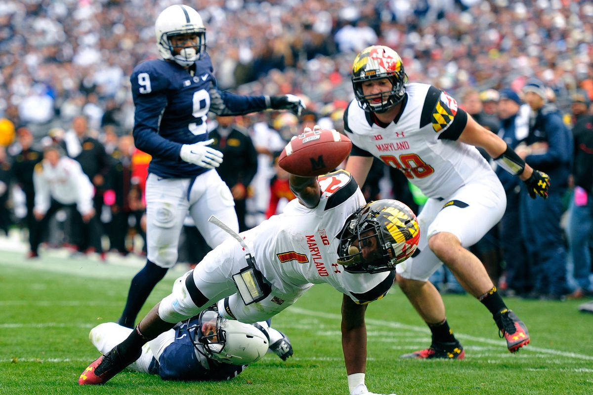 Stefon Diggs reaches for the goal line in the fourth quarter against Penn State. He stayed down on the field, injured, after a similar attempt on Maryland's previous drive.