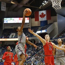 UConn�s Crystal Dangerfield (5) goes up for a layup in front of Maryland's Sarah Myers (21).