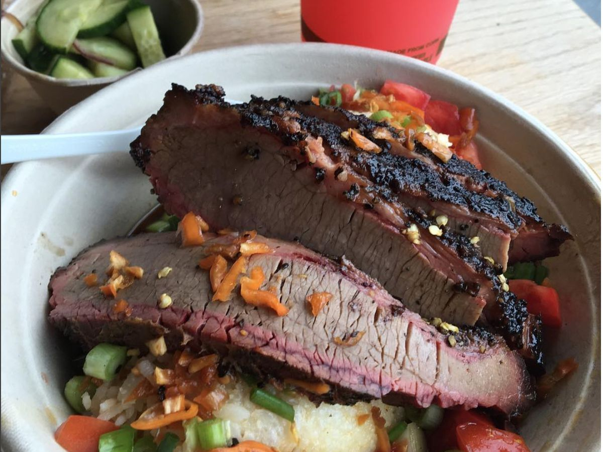 Barbecue sliced in a bowl with veggies.