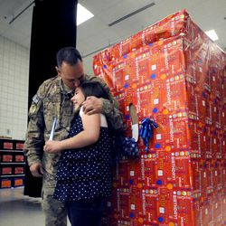 Air Force Tech Sgt. Edward Goettig shares a moment with his 10-year-old daughter Olivia, whose birthday present was her dad coming home earlier than she thought at Fox Hollow Elementary School in Lehi on Thursday, March 6, 2014. Goettig had been deployed to Afghanistan since Aug. 27, 2013.