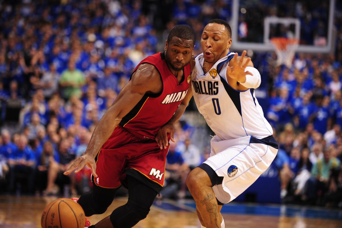 Dwayne Wade (L) of the Miami Heat is def