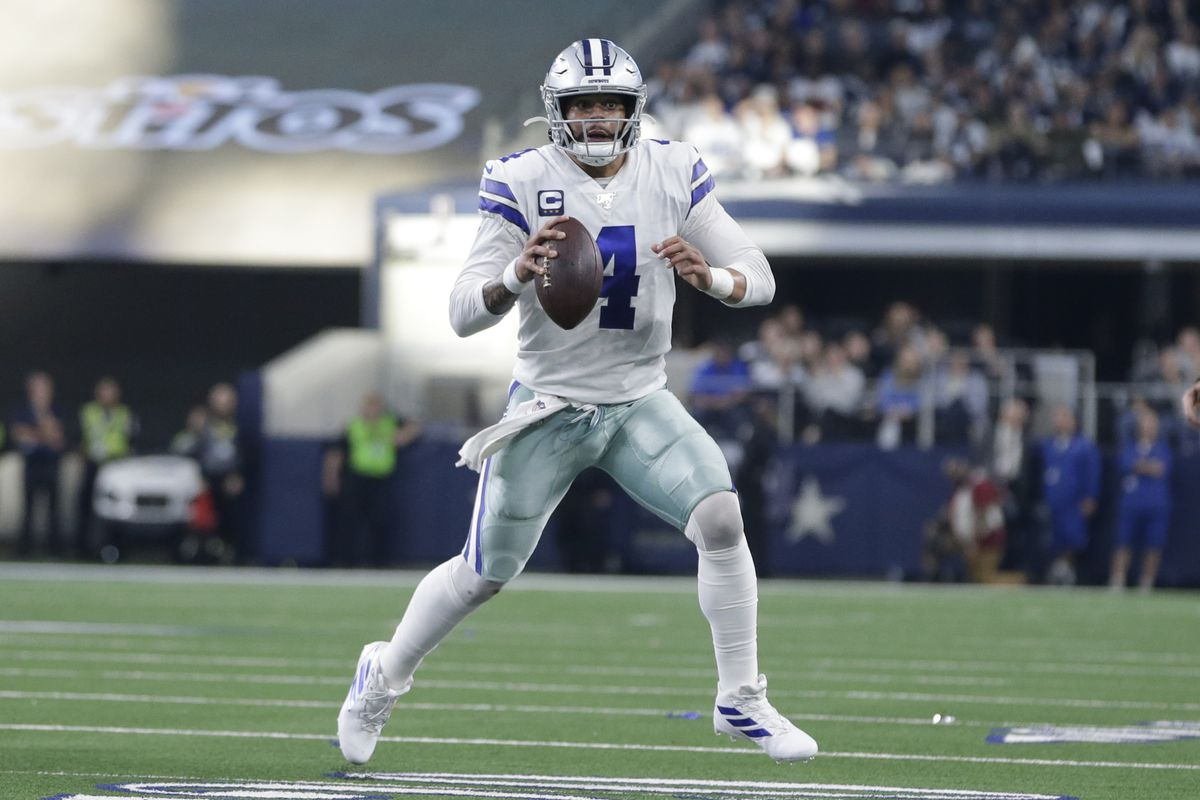 Dallas Cowboys quarterback Dak Prescott moves out to pass in the first quarter against the Washington Redskins at AT&T Stadium.