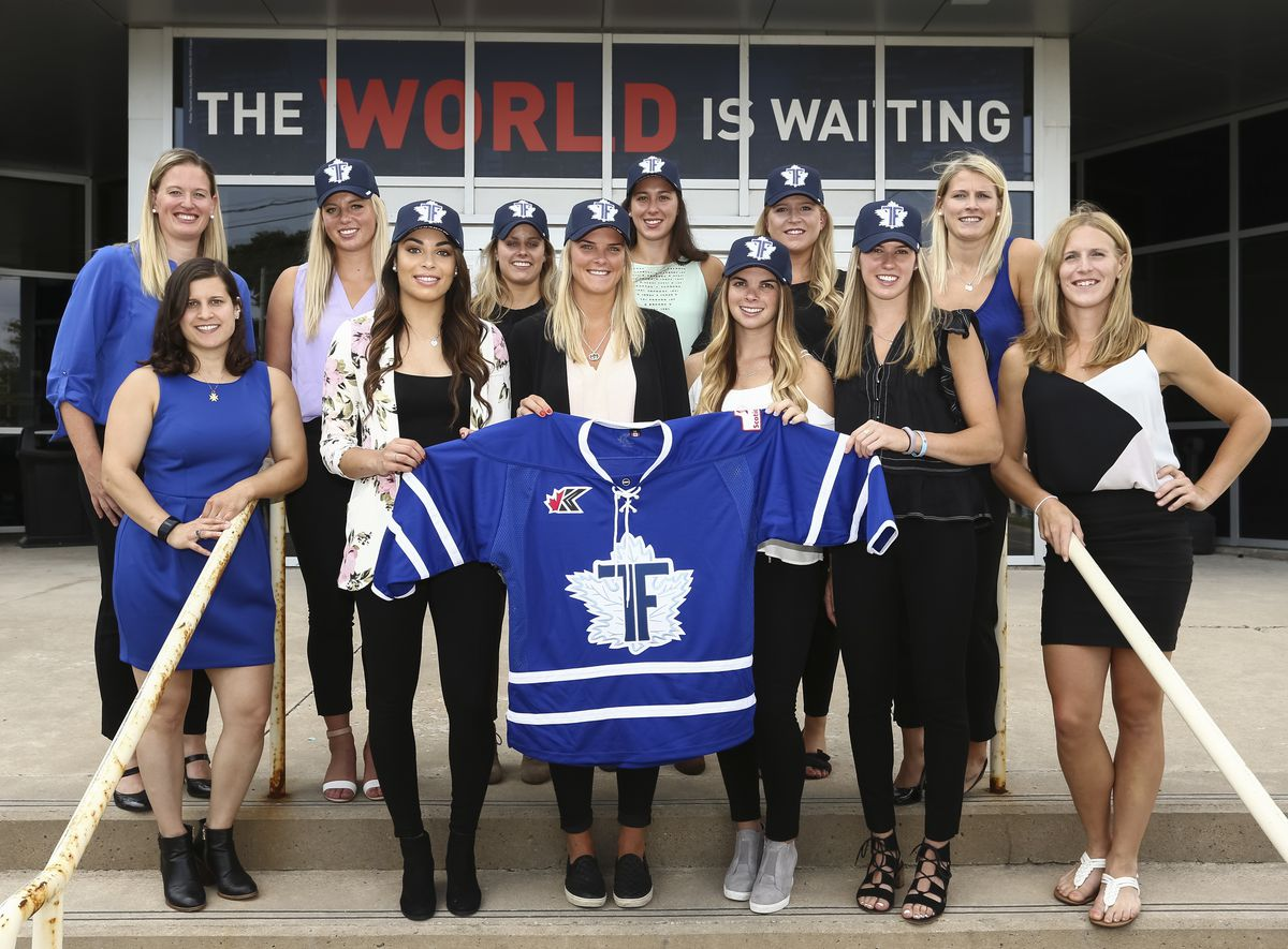 2018 CWHL Draft - Toronto Furies picks holding a Furies jersey while standing on the steps of the Mastercard Centre