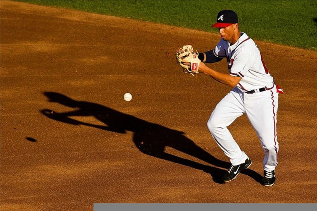 March 14, 2012; Lake Buena Vista, FL, USA; Atlanta Braves shortstop Andrelton Simmons (67) fields a ground ball in the first inning of the game against the Washington Nationals at Champion Stadium. Mandatory Credit: Daniel Shirey-US PRESSWIRE