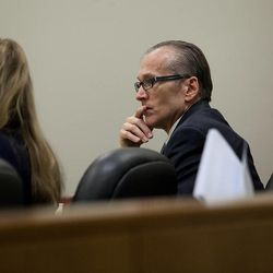 Martin MacNeill sits with his defense counsel during a morning recess at 4th District Court in Provo Wednesday, Nov. 6, 2013. MacNeill is charged with murder for allegedly killing his wife, Michele MacNeill, in 2007.