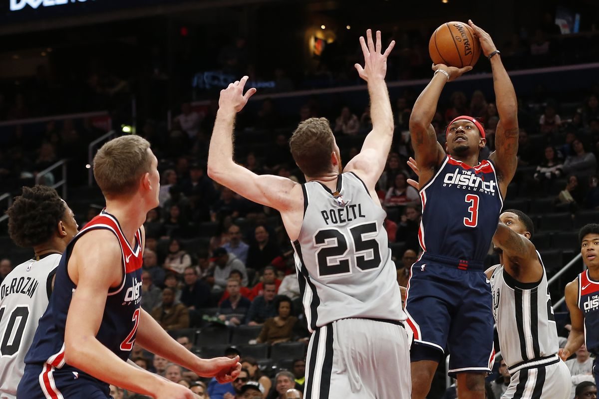Washington Wizards guard Bradley Beal shoots the ball over San Antonio Spurs center Jakob Poeltl in the second quarter at Capital One Arena.