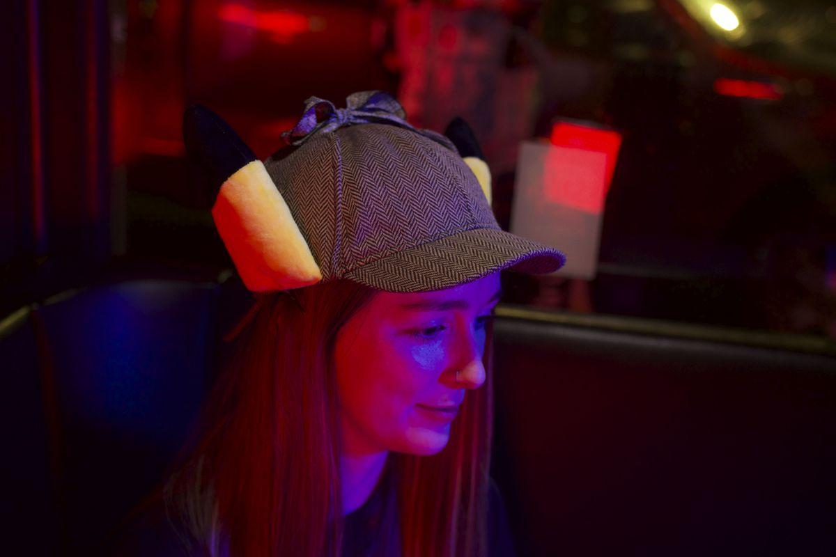 girl wearing Detective Pikachu deerstalker hat
