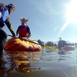 Ross Bowman gets situated in his pumpkin before taking part in the 2013 Mountain Valley Seed Co. Ginormous Pumpkin Regatta at Sugarhouse Park on Saturday, October 19, 2013.